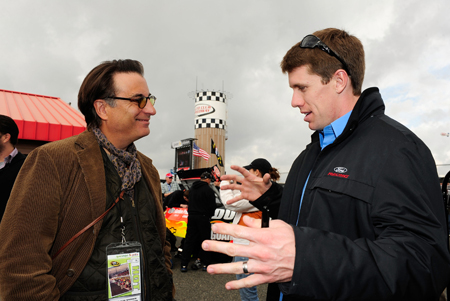 Actor and race Grand Marshall Andy Garcia talks with Carl Edwards, driver of the No. 99 Aflac Ford, in the garage area before Sunday's NASCAR Sprint Cup Series Auto Club 500 at Auto Club Speedway. (Credit: Rusty Jarrett/Getty Images for NASCAR)