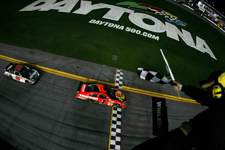 Jamie McMurray crosses the finish line .119 seconds ahead of Dale Earnhardt Jr. to win the Daytona 500 at Daytona International Speedway.(Credit: Todd Warshaw/Getty Images for NASCAR)