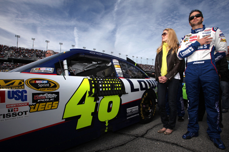 Jimmie Johnson, driver of the No. 48 Lowe's Chevrolet, and his wife Chandra stand next to his car during the national anthem before the first NASCAR Sprint Cup Series Gatorade Duel at Daytona International Speedway on Thursday. (Credit: Jonathan Ferrey/Getty Images for NASCAR)