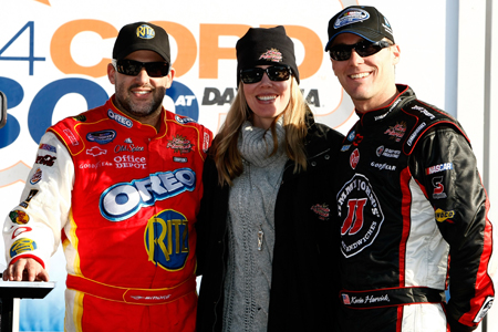 (Left to right) Tony Stewart stands in Daytona International Speedway's Victory Lane with car owners DeLana Harvick and Kevin Harvick. Kevin also finished third in the DRIVE4COPD 300 on Saturday. (Credit: Jonathan Ferrey/Getty Images for NASCAR)