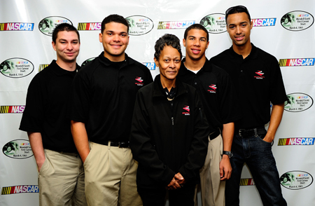 NASCAR Drive for Diversity drivers (from left) Jason Romero, Ryan Gifford, Darrell Wallace Jr., Michael Cherry pose with daughter of NASCAR legend Wendell Scott, Sybil Scott, after a press conference at Atlanta Motor Speedway. A decal featuring Wendell Scotts image was revealed during the Saturday press conference. (Credit: Rusty Jarrett/Getty Images for NASCAR)