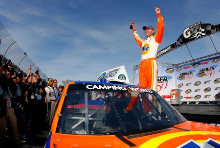 Kevin Harvick celebrates winning the Kroger 250 at Martinsville Speedway, his fourth consecutive victory in the NASCAR Camping World Truck Series. (Credit: Jason Smith/Getty Images for NASCAR)