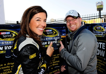 Miss Sprint Monica Palumbo poses with James Bryant of Clover, S.C., after he cast the first official fan vote for the NASCAR Sprint All-Star race during testing at Charlotte Motor Speedway on Wednesday.(Credit: Rusty Jarrett/Getty Images for NASCAR)