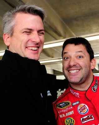 Engineer Matt Borland and driver Tony Stewart mug for the camera in the garage during Tuesday's (March 23, 2010) testing at Charlotte Motor Speedway. (Credit: Rusty Jarrett/Getty Images for NASCAR)