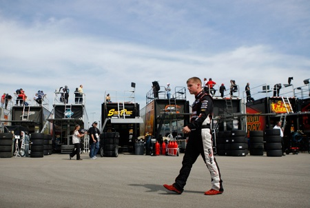 Justin Allgaier, driver of the #12 Verizon Wireless Dodge walks in the garage area during practice for the NASCAR Nationwide Series Nashville 300. (Credit: Jason Smith/Getty Images for NASCAR)
