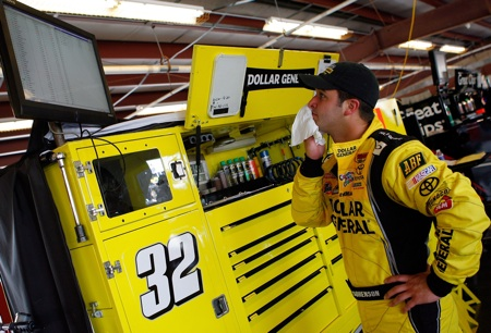 Driver of the #32 Dollar General Toyota, Reed Sorenson, watches scoring in the garage area during practice Friday while he prepares for the Nashville 300. (Credit: Jason Smith/Getty Images for NASCAR)