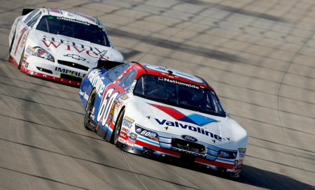 Carl Edwards battles Scott Wimmer for position during Saturday's NASCAR Nationwide Series Nashville 300 at Nashville Superspeedway. (Credit: John Sommers II/Getty Images for NASCAR)