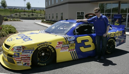Dale Earnhardt Jr. stands next to the No. 3 Wrangler Chevrolet at JR Motorsports in Mooresville, N.C. Thursday. He will run the car in the NASCAR Nationwide Series at Daytona International Speedway on July 2.