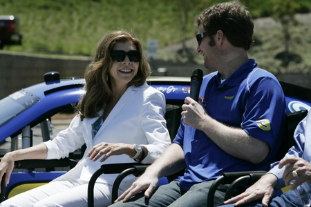 (Left to right) Teresa Earnhardt and Dale Earnhardt Jr. share a smile Thursday during a news conference at JR Motorsports in Mooresville, N.C. unveiling the No. 3 NASCAR Nationwide Series car that Earnhardt Jr. will run July 2 at Daytona International Speedway.