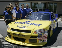 (Front row, left to right) Taylor Earnhardt, Teresa Earnhardt, Kelley Earnhardt, Dale Earnhardt Jr., Richard Childress (Back row left to right) Wrangler VP of Marketing Craig Errington and Kerry Earnhardt stand behind the No. 3 NASCAR Nationwide Series new car at JR Motorsports in Mooresville, N.C. on Thursday. Earnhardt Jr. will run it July 2 at Daytona International Speedway. Credit: Mary Ann Chastain/Getty Images for NASCAR