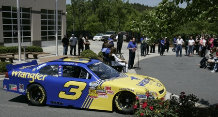 Host Winston Kelley begins a news conference Thursday at JR Motorsports in Mooresville, N.C. unveiling the No. 3 NASCAR Nationwide Series car that Dale Earnhardt Jr. will run July 2 at Daytona International Speedway.