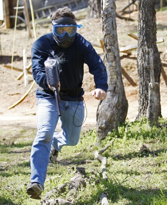 SPEED TV's Hermie Sadler runs through the field while playing paintball for charity at an event hosted by Richmond International Raceway on Wednesday. (Credit: Geoff Burke/Harrelson Photography)