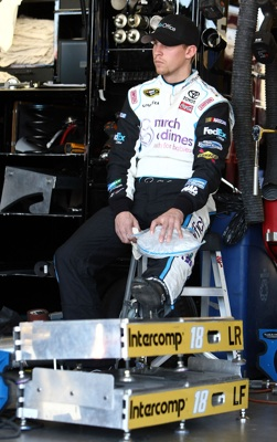 Denny Hamlin ices his knee in the garage after turning the quickest lap in the first practice for the Subway Fresh Fit 600 at Phoenix International Raceway.(Credit: Jonathan Ferrey/Getty Images)