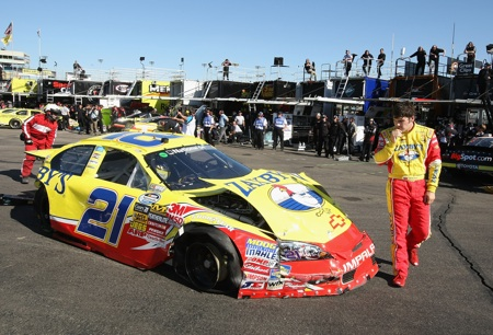 John Wes Townley inspects the damage on his No. 21 Zaxby's Chevrolet after an accident in practice. Clint Bowyer will take over driving duties in the No. 21 for the Bashas' Supermarkets 200.(Credit: Christian Peterson/Getty Images)