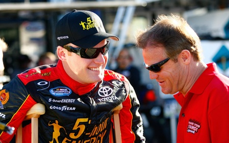 Steve Wallace (with crutches) chats with uncle Kenny Wallace before Friday's final practice for the Bashas' Supermarkets 200 at Phoenix International Raceway.(Credit: Geoff Burke/Getty Images for NASCAR)