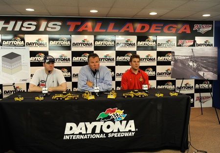 Daytona International Speedway President Robin Braig is joined by Dale Earnhardt Jr. and Jamie McMurray in announcing the track will repave the track surface before the 2011 Daytona 500. (Credit: Rusty Jarrett/Getty Images for NASCAR)