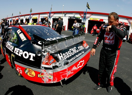 Ryan Newman inspects the damage to his car after an accident in the final practice for the Aaron&#039;s 499 at Talladega Superspeedway. (Credit: Jason Smith/Getty Images for NASCAR)