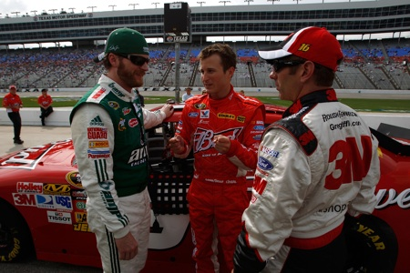 (Left to right) Dale Earnhardt Jr., future Hendrick Motorsports teammate Kasey Kahne and Greg Biffle talk on pit road during Coors Light Pole qualifying Friday at Texas Motor Speedway in Fort Worth, Texas. (Credit: Chris Graythen/Getty Images)