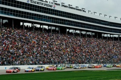Fans filled the stands for a Monday double-header as Tony Stewart leads the field at the start of the NASCAR Sprint Cup Series Samsung Mobile 500 at Texas Motor Speedway. The track honored all tickets, so fans were allowed to see races (the NASCAR Nationwide Series O'Reilly 300 followed the Sprint Cup race) for the price of one. (Credit: Rusty Jarrett/Getty Images for NASCAR)