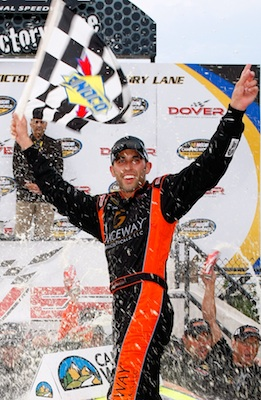 Aric Almirola celebrates his first NASCAR Camping World Truck Series win in Victory Lane at Dover International Speedway. He called the win a dream come true. (Credit: Geoff Burke/Getty Images for NASCAR)