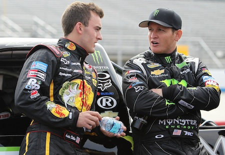 Austin Dillon catches up with fellow driver Ricky Carmichael on the grid during qualifying for Friday's Dover 200 at Dover International Speedway. (Credit: Nick Laham/Getty Images)