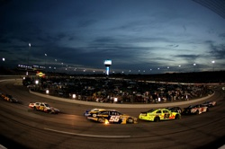 Racing under the lights at Richmond International Raceway on Saturday. (Credit: Al Bello/Getty Images for NASCAR)