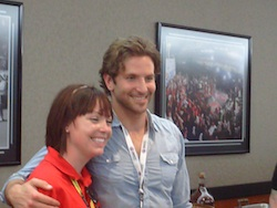 Actor Bradley Cooper takes a photo with a fan at Charlotte Motor Speedway on Sunday, May 30th, 2010 (photo credit: The Fast and the Fabulous)