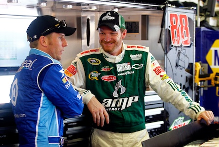 (Left to right) Jamie McMurray and his NASCAR Nationwide Series owner Dale Earnhardt Jr. talk during NASCAR Sprint Cup Series practice Saturday at Michigan International Speedway in Brooklyn, Mich.