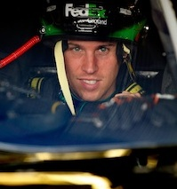 NASCAR Sprint Cup Series driver Denny Hamlin smiles as he gets behind the wheel during practice on Friday to dial in his car for a fifth win of the season at Michigan International Speedway in Brooklyn, Mich. (Credit: Geoff Burke/Getty Images for NASCAR)
