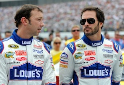 (Left to right) Crew chief Chad Knaus talks with Jimmie Johnson before the NASCAR Sprint Cup Series LENOX Industrial Tools 301 at New Hampshire Motor Speedway Sunday in Loudon, N.H. (Credit: Rusty Jarrett/Getty Images for NASCAR)