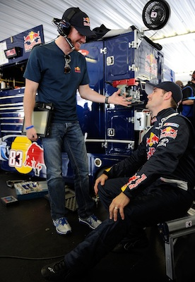 Brian Vickers goes over practice notes with teammate Casey Mears, who is driving the No. 83 Red Bull Toyota now that Vickers is out for the season with a medical issue. (Credit: Rusty Jarrett/Getty Images for NASCAR)