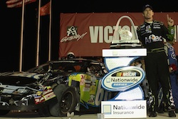 Carl Edwards driver of the #60 Aflac Ford poses with the trophy after winning the NASCAR Nationwide Series Missouri-Illinois Dodge Dealers 250 at Gateway International Raceway on July 17, 2010 in Madison, Illinois.  (Photo by Dilip Vishwanat/Getty Images for NASCAR)