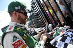 Dale Earnhardt Jr., driver of the No. 88 AMP Energy/National Guard Chevrolet, signs autographs for race fans during the Aug. 1 NASCAR Sprint Cup Series event at Pocono Raceway (Courtesy Hendrick Motorsports).