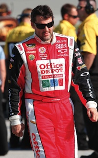 Tony Stewart wears the firesuit that's up for auction at OfficeDepotRacing.com