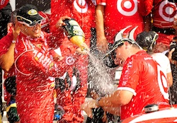 (Left to right) Juan Pablo Montoya and crew chief Brian Pattie spray each other with champagne in Watkins Glen International's Victory Lane after Pattie claimed his first victory atop the box in the NASCAR Sprint Cup Series on Sunday at Watkins Glen International in Watkins Glen, N.Y. (Credit: Rusty Jarrett/Getty Images for NASCAR)