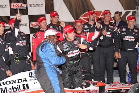 Terrell Owens celebrates in Victory Lane with Helio Castroneves
