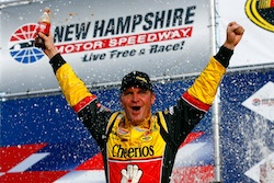 Clint Bowyer celebrates second career NASCAR Sprint Cup Series victory on Sunday at the New Hampshire Motor Speedway in Loudon, N.H., the first race in the Chase for the NASCAR Sprint Cup. (Credit: Jason Smith/Getty Images for NASCAR)