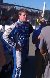 Carl Edwards waits to be interviewed post-qualifying for the CampingWorld.com 300 at Auto Club Speedway in Fontana, Calif. on Saturday, October 9, 2010 (credit: The Fast and the Fabulous)