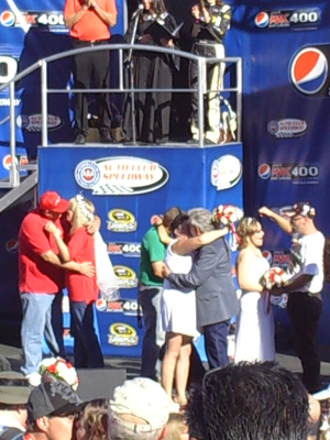 10/10/10 wedding kiss at Auto Club Speedway