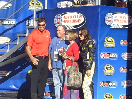 Couples take photos with Michael Waltrip and Miss Sprint Cup