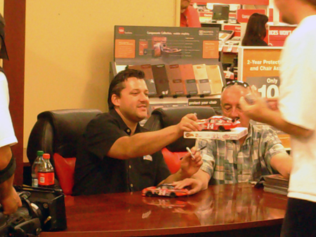 Tony Stewart signs autographs for his fans at the Office Depot store in Rancho Cucamonga, California on Thursday, October 7, 2010 (photo credit: The Fast and the Fabulous)