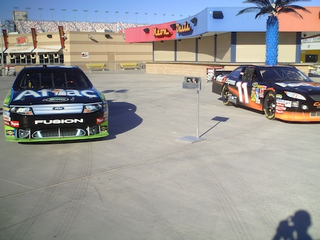 The No. 99 Aflac Ford and No. 11 FedEx Toyota on display for the Chasers for Charity Fanfest inside the Neon Garage at Las Vegas Motor Speedway on Wednesday, December 1, 2010.