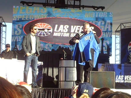 Jimmie Johnson helps auction off a jacket that was signed by all 12 of the Chase drivers