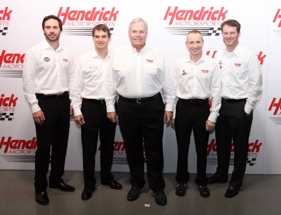 (Left to right) Five-time NASCAR Sprint Cup Series champion Jimmie Johnson, four-time NASCAR Sprint Cup Series champion Jeff Gordon, owner Rick Hendrick and NASCAR Sprint Cup Series drivers Mark Martin and Dale Earnhardt Jr. pose for a team picture Wednesday at Hendrick Motorsports Media Day during the Sprint Media Tour hosted by Charlotte Motor Speedway.(Credit: Jason Smith/Getty Images for NASCAR)