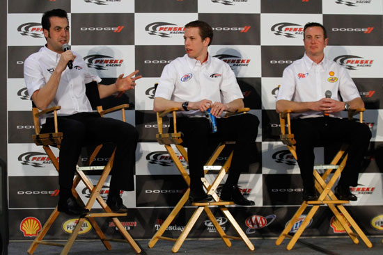 (Left to right) Sam Hornish Jr., driver of the No. 12 Alliance Truck Parts Dodge in the NASCAR Nationwide Series, speaks to the media as NASCAR Sprint Cup Series teammates Brad Keselowski, driver of the No. 2 Miller Lite Dodge, and Kurt Busch, driver of the No. 22 Shell/Pennzoil Dodge, look on during the NASCAR Sprint Media Tour hosted by Charlotte Motor Speedway, held at Penske Racing on Monday in Mooresville, N.C.(Credit: Jason Smith/Getty Images for NASCAR)