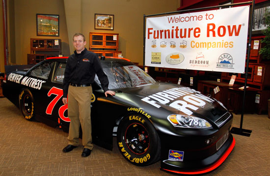 NASCAR Sprint Cup Series driver Regan Smith stands in front of his No. 78 Furniture Row ride during the Sprint Media Tour hosted byCharlotte Motor Speedway on Wednesday in Charlotte, N.C. (Credit: Jason Smith/Getty Images for NASCAR)