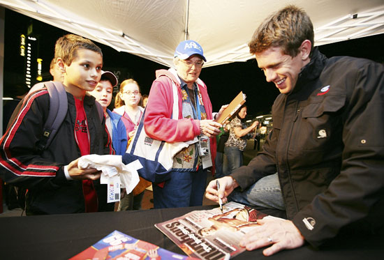 NASCAR Sprint Cup Series driver Carl Edwards signs autographs for young fans during the Preseason Thunder Fan Fest following testing Thursday at Daytona International Speedway in Daytona Beach, Fla. (Credit: Jerry Markland/Getty Images for NASCAR)