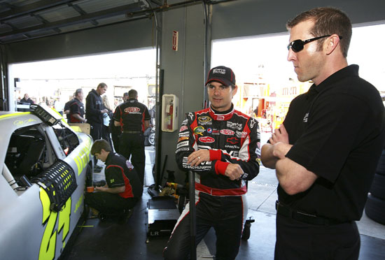 Jeff Gordon works with Ormond Beach, Fla. native Alan Gustafson in the Garage Thursday at Daytona International Speedway in Daytona Beach, Fla. (Credit: Jerry Markland/Getty Images for NASCAR)