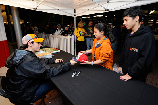 Joey Logano who was third fastest with a lap time of 45.757 seconds signs autographs for fans during Preseason Thunder Fan Fest on Friday at Daytona International Speedway in Daytona Beach, Fla.(Credit: Jared C. Tilton/Getty Images for NASCAR)