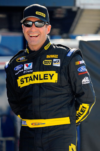NASCAR Sprint Cup Series driver Marcos Ambrose smiles in the garage Saturday at Daytona International Speedway in Daytona Beach, Fla. during Preseason Thunder testing.(Credit: Jared C. Tilton/Getty Images for NASCAR)